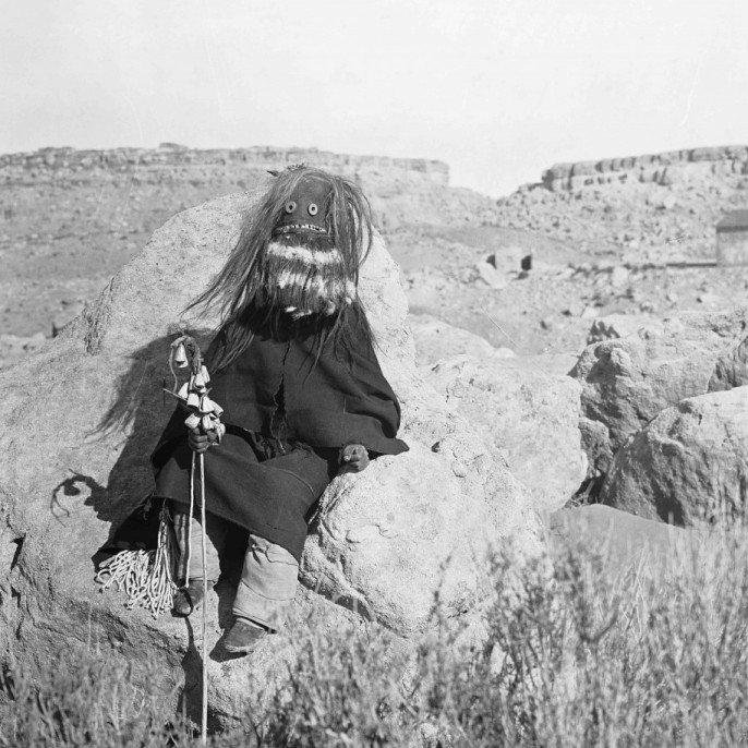McKern, Underwood & Underwood, Masked Hopi sitting on rocks, 1905. Collection of the California Museum of Photography at UCR ARTSblock, The Keystone-Mast Collection