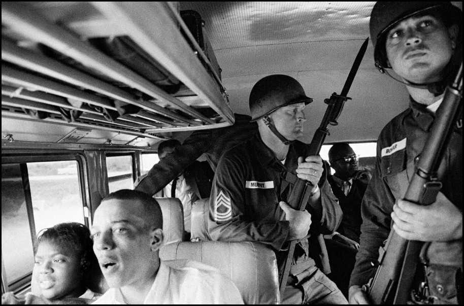 Bruce Davidson USA. Montgomery, Alabama. 1961. National Guard soldiers escort Freedom Riders along their ride from Montgomery to Jackson, Mississippi.