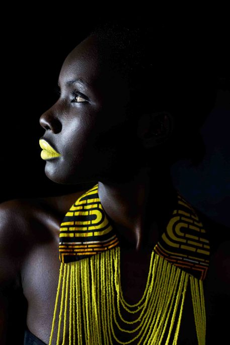 The South Africa-based Ugandan model Patricia Akello wears a necklace by the Ugandan label Halisi, 2015.
