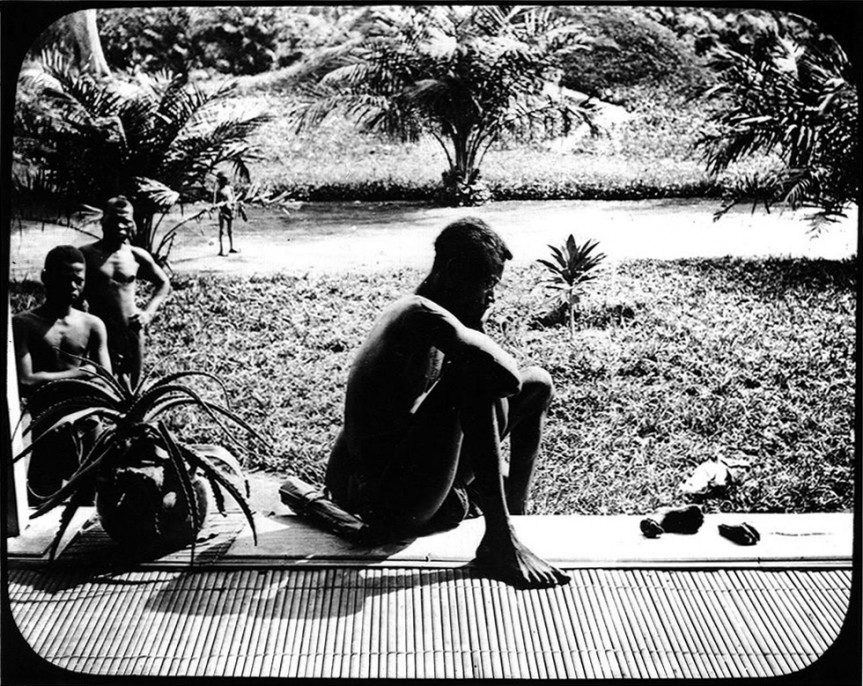 Alice Seeley Harris, a missionary stationed in the Congo Free State, took this photo of Nsala of Wala with the severed hand and foot of his five year-old daughter murdered by ABIR militia, a result of King Leopold of Belgium's brutal colonial rule. This was all that remained of a cannibal feast following the murder of his wife, son and daughter. Harris documented the atrocities with a Kodak dry plate camera and shared these images in slideshows across Europe and the United States. Ndongo District, Congo Free State, c. 1904, Alice Seeley Harris, Courtesy Anti-Slavery International / Autograph ABP.