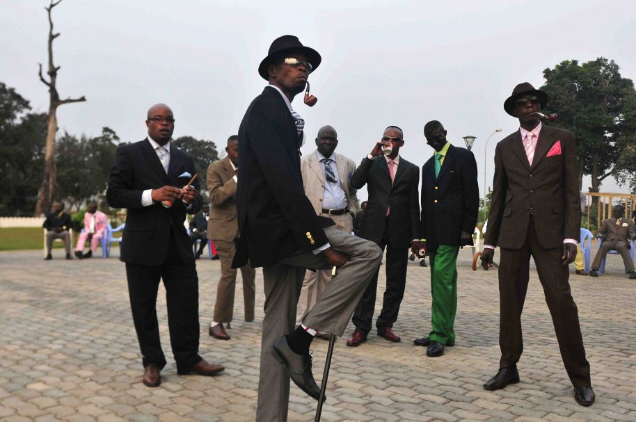 Daniele Tamagni, The Playboys, Sapeurs posing in front of Memorial Savorgnan de Brazza (from the Gentlemen of Bacongo series), 2008. Lambda c-print, Ed. 2. 10, 66.3 x 92.5 cm. Courtesy October Gallery London