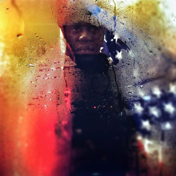 Ruddy Roye Colours (Marlon Jones) (Immigrant Series), New York, NY, July 4, 2014 - TBC Archival pigment print on metallic paper, printed 2016 35 x 35 in Edition of 10; Signed by photographer verso