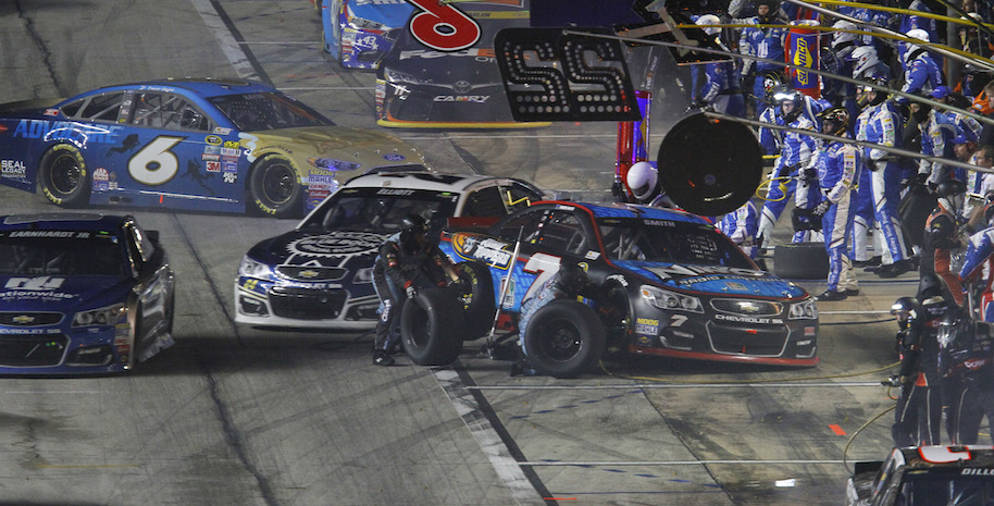 Regan Smith, 7, had to enter his pit box at an angle, making it harder for Chase Elliott, 24, to get out past his crew during the competition caution early in the AAA Texas 500 on Sunday, Nov. 6, 2016 at Texas Motor Speedway in Fort Worth, Texas. (David Kent/Fort Worth Star-Telegram/TNS via Getty Images)