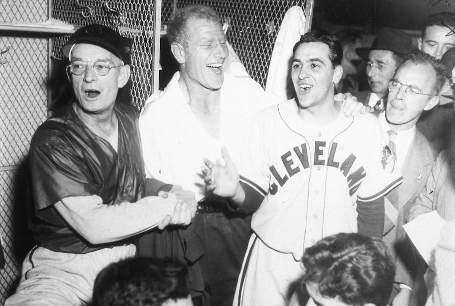 The Cleveland Indians celebrate their World Series win over the Braves in Boston on October 11, 1948. (L-R) are coach Bill McKechnie, owner Bill Veeck, and manager Lou Boudreau (Photo by Mark Rucker/Transcendental Graphics, Getty Images)