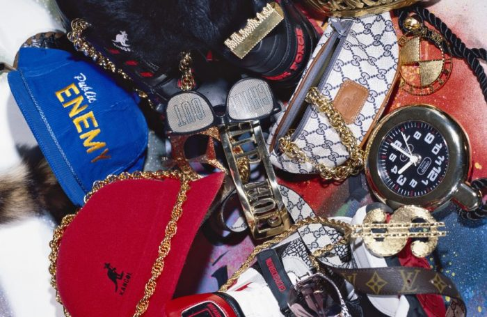 Hip Hop Ephemera shot by Normski in 1994 on the floor of his home. The accessories, loaned by Camden's 4 Star General in London, included snakeskin Cazal glasses, Task Force trainers and a Flavor Flav clock. © Normski