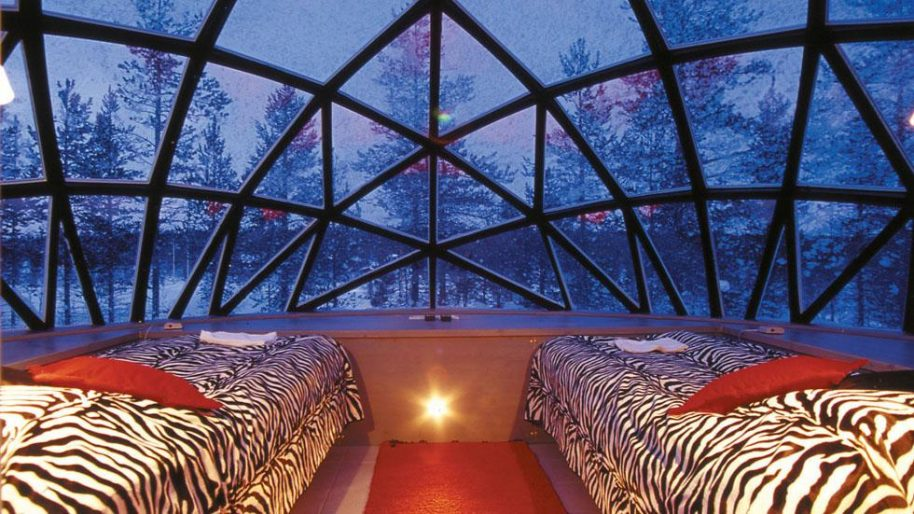 Hotel Kakslauttanen has glass igloos fit for two that come with a toilet and are thermal heated. Photo courtesy of Hotel Kakslauttanen and Igloo Village.