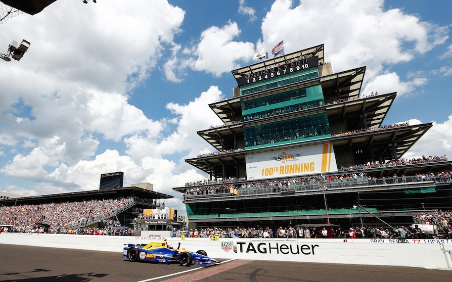 Alexander Rossi of the United States pumps his fist as he takes the checkered flag to win the 100th running of the Indianapolis 500 at Indianapolis Motorspeedway on May 29, 2016 in Indianapolis, Indiana. (Photo by Jamie Squire/Getty Images)