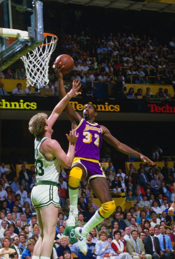 Magic Johnson #32 of the Los Angeles Lakers goes up to shoot over Larry Bird #33 of the Boston Celtics during the 1985 NBA Basketball Finals at the Boston Garden. (Photo by Focus on Sport/Getty Images)