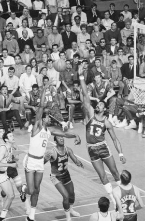 1969 NBA Finals: Lakers' Wilt Chamberlain (13) tries to block shot by Celtics' player-coach Bill Russell (6) during 1st qtr. action at Boston Garden.