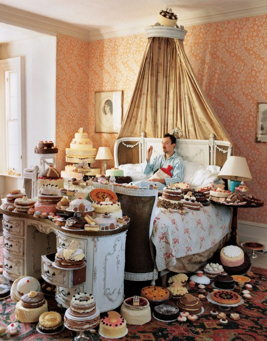 Tim Walker, Self-Portrait with Eighty Cakes, 2008; from Feast for the Eyes (Aperture, 2017). © Tim Walker.