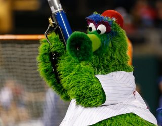 Woman Gets Face Busted Up By Phillie Phanatic's Wiener Launcher
