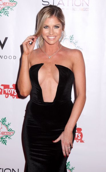 Playmate Carly Lauren attends The BenchWarmer 10th Annual Winter Wonderland Toys For Tots Christmas Celebration