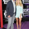 Singer Carrie Underwood (R) and husband Mike Fisher attend the 2013 CMT Music Awards