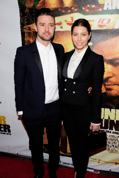 Singer/actor Justin Timberlake (L) and actress Jessica Biel arrive at the world premiere of Twentieth Century Fox and New Regency's film 'Runner Runner'