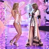 Karlie Kloss walks the runway as Taylor Swift performs at the annual Victoria's Secret fashion show