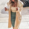 Kim Kardashian shows off her cleavage as she departs Barneys New York