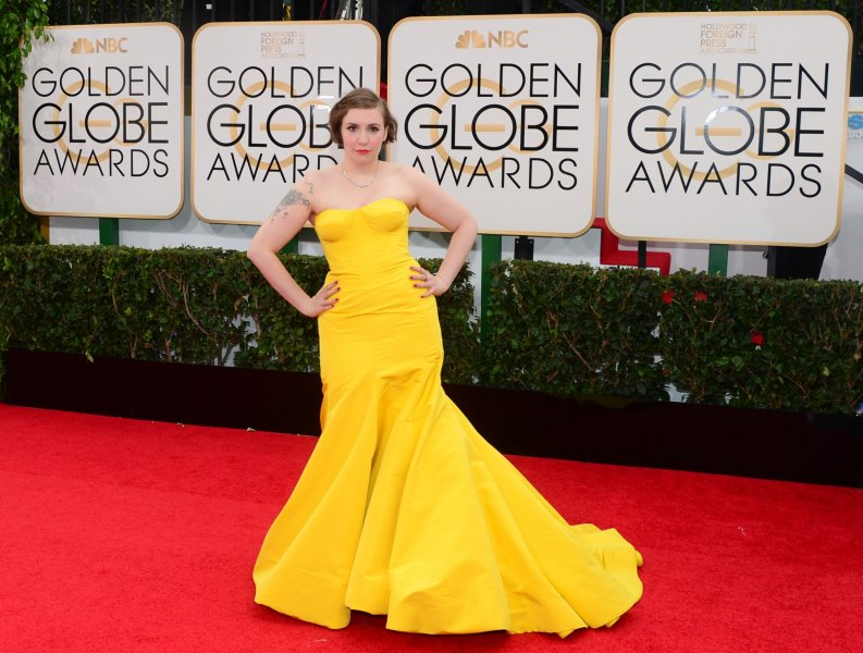 Actress and director Lena Dunham arrives on the red carpet for the Golden Globe awards on January 12, 2014