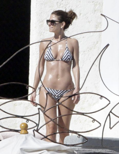 Maria Menounos shows off her toned figure as she sunbathes in Los Cabos