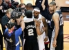 LeBron Gives Hugs, Duncan Looks On.