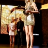 Singer Taylor Swift accepts the Favorite Country Album award for 'Red' onstage during the 2013 American Music Awards