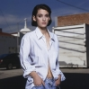 Winona Ryder standing with her hands in her pockets, circa 1989
