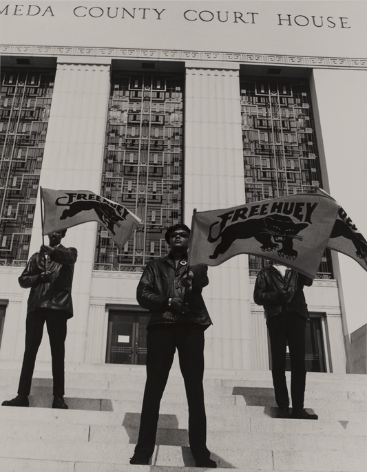 """Black Panther demonstration, Alameda Co. Court House, Oakland, CA, during Huey Newton's trial,"" Pirkle Jones; 1968."