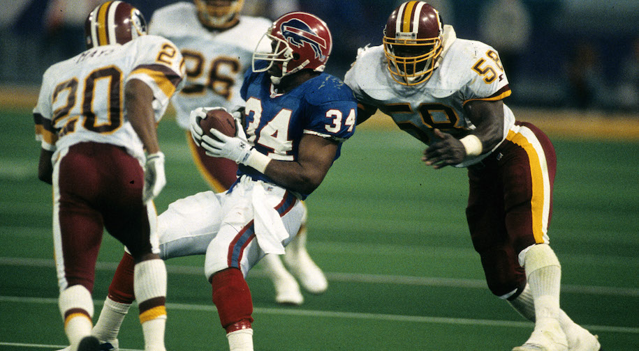 Washington Redskins cornerback Alvoid Mays (20) and linebacker Wilbur Marshall (58) corner Buffalo Bills Hall of Fame running back Thurman Thomas (34) during Super Bowl XXVI, a 37-24 Redskins victory on January 26, 1992, at the Hubert H. Humphrey Metrodome in Minneapolis, Minnesota. (Photo by Rob Brown/Getty Images) *** Local Caption ***
