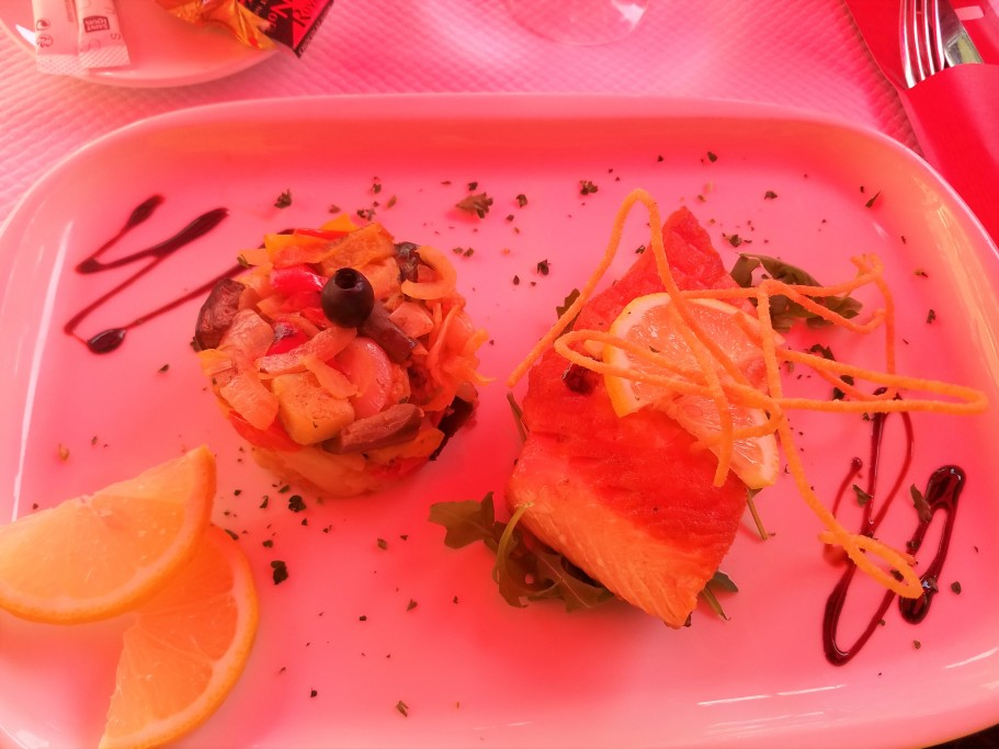 Salmon steak served with garden vegetables. Photo by Akil Wingate.