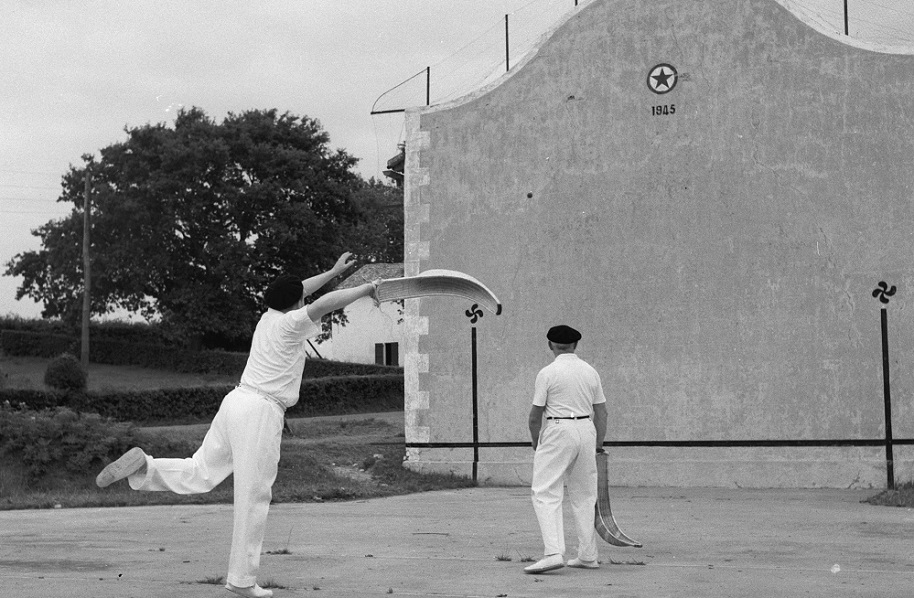 circa 1955: Two men playing a game of pelota, a Basque game which uses a 'cesta', a basket-like raquet attached to the hand, to hurl a pellet made of leather and rubber. (Photo by George Pickow/Three Lions/Getty Images)
