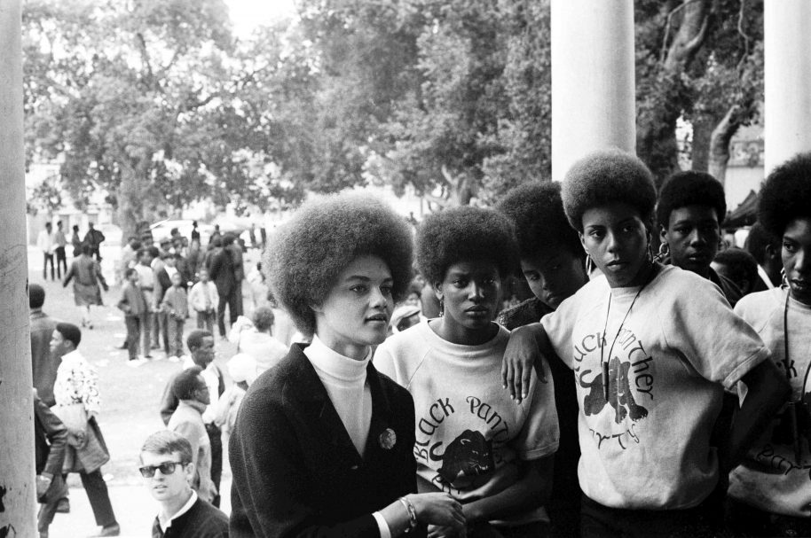 July 28, 1968 - Oakland, California, USA: Kathleen Cleaver, communications secretary and the first female member of the Party's decision-making Central Committee, talks with Black Panthers from Los Angeles who came to the Free Huey rally in DeFremery Park (named by the Panthers Bobby Hutton Park) in West Oakland (Stephen Shames/Polaris)