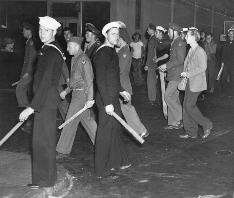 """U.S. armed forces personnel with wooden clubs on street during """"zoot suit"""" riot, Los Angeles, Calif., 1943. Courtesy of Visual Materials from the National Association for the Advancement of Colored People Records/ Library of Congress."""