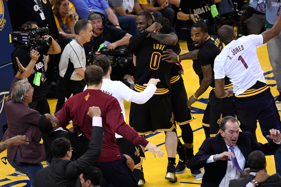 OAKLAND, CA - JUNE 19: LeBron James #23 and Kevin Love #0 of the Cleveland Cavaliers celebrate after defeating the Golden State Warriors 93-89 in Game 7 of the 2016 NBA Finals at ORACLE Arena on June 19, 2016 in Oakland, California. NOTE TO USER: User expressly acknowledges and agrees that, by downloading and or using this photograph, User is consenting to the terms and conditions of the Getty Images License Agreement. (Photo by Thearon W. Henderson/Getty Images)