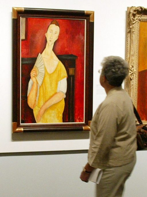 Woman with a Fan by Amedeo Modigliani. Photo: DON EMMERT/AFP/Getty Images)