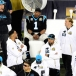Cam Newton sits on the bench as a sad onlooker