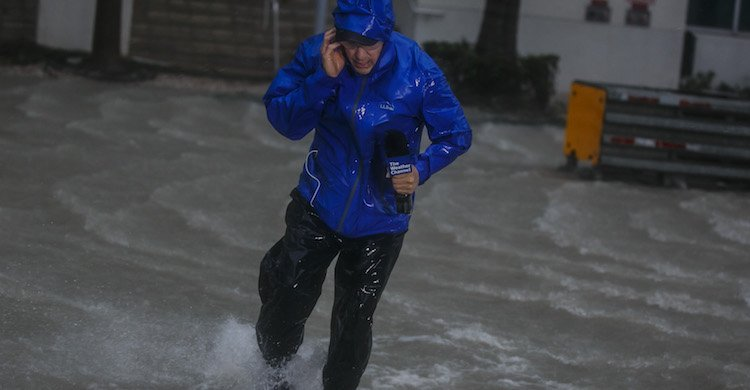 Weatherman Dominated By Hurricane Florence (Until Two Bros Stroll By)