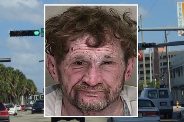 Meanwhile in Florida: Man Arrested For Hanging From Traffic Lights and Pooping on Cars, Stuck the Landing