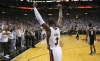 D-Wade Lifts Arms In Triumph.